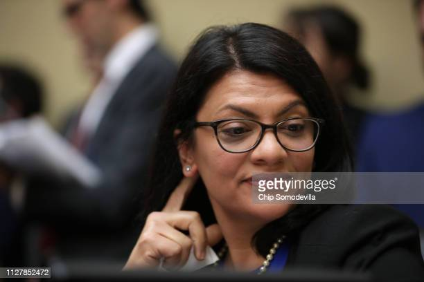 Rep. Rashida Tlaib listens to Michael Cohen, former attorney and fixer for President Donald Trump, testify before the House Oversight Committee on...