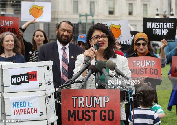 Rep Rashida Tlaib speaks during an event with activist groups to deliver over ten million petition signatures to Congress urging the US House of...