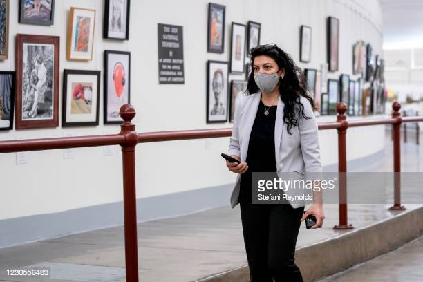 Rep. Rashida Tlaib wears a protective mask while walking through the Canon Tunnel to the U.S. Capitol on January 12, 2021 in Washington, DC. Today...