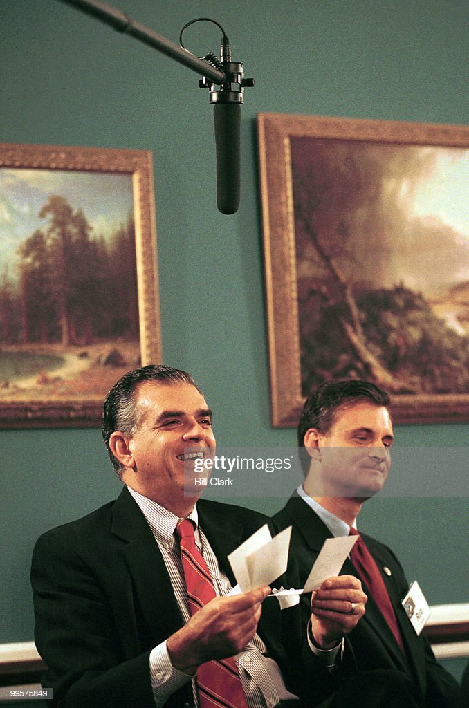 Rep. Ray LaHood (left) goes through his daily schedule as Rep. Robert Andrews looks on during taping of a MSNBC program on life in Congress.