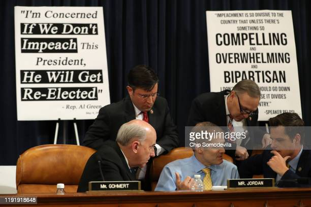 Rep Rep Louie Gohmert Rep Mike Johnson Rep Jim Jordan Rep Andy Biggs and Rep Matt Gaetz confer during a break as constitutional scholars Noah Feldman...