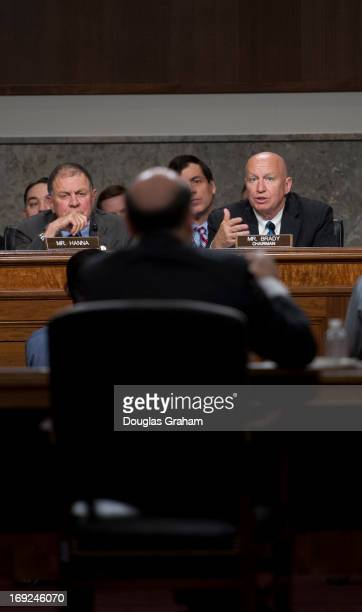 Rep Richard Hanna RNY and Rep Kevin Brady RTX listen to Ben Bernanke Chairman Board of Governors of the Federal Reserve System as he testifies before...