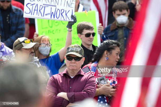 Rep Robert Sutherland gathers with hundreds of others at a 'Hazardous Liberty Defend the Constitution' rally to protest the stayathome order at the...