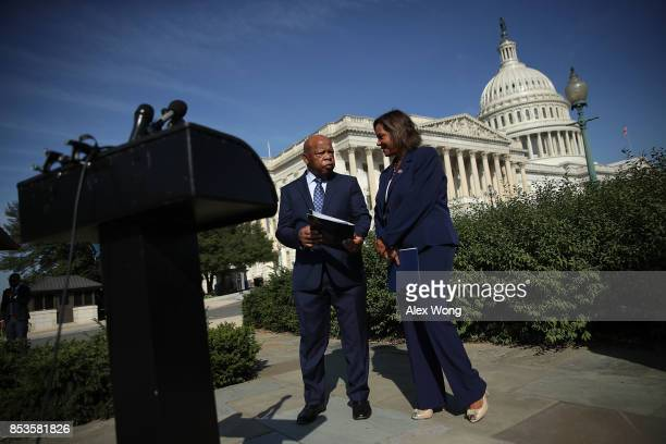 S Rep Robin Kelly talks to Rep John Lewis prior to a news conference September 25 2017 on Capitol Hill in Washington DC Reps Lewis and Kelly were...