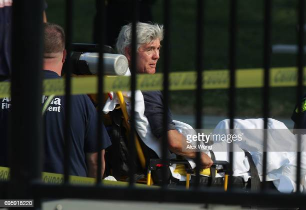 S Rep Roger Williams is wheeled away by emergency medical service personnel from the Eugene Simpson Stadium Park June 14 2017 in Alexandria Virginia...