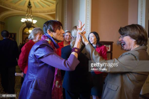 S Rep Rosa DeLauro L high fives US Sen Amy Klobuchar before a press conference to urge Congress to pass the Paycheck Fairness Act on Capitol Hill...