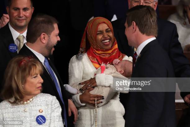 Rep Ruben Gallego and Rep Eric Swalwell speaks with Repelect Ilhan Omar during the first session of the 116th Congress at the US Capitol January 03...