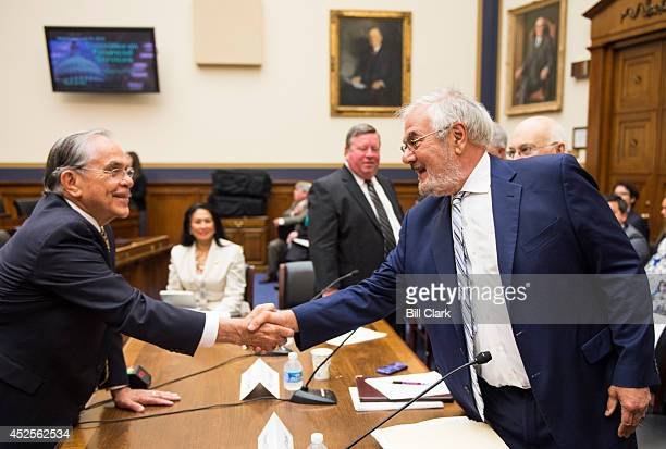 Rep Ruben Hinojosa DTexas left greets hearing witness former Rep Barney Frank DMass during the House Financial Services Committee hearing on...