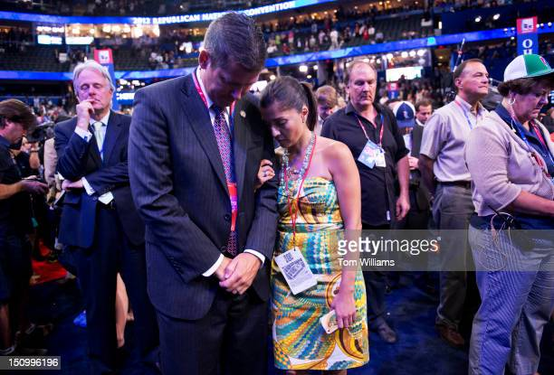 Rep Sean Duffy RWisc and his wife Rachel CamposDuffy bow their heads in prayer on the night Rep Paul Ryan RWisc republican vicepresidential nominee...