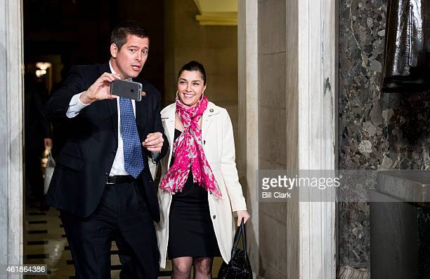 Rep Sean Duffy RWisc shoots a video selfie with his wife Rachel CamposDuffy in Statuary Hall before President Barack Obama's State of the Union...