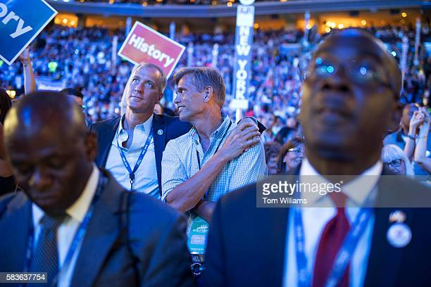 Rep Sean Patrick Maloney DNY and his husband Randy Florke back right appear on the floor of the Wells Fargo Center in Philadelphia Pa on the second...