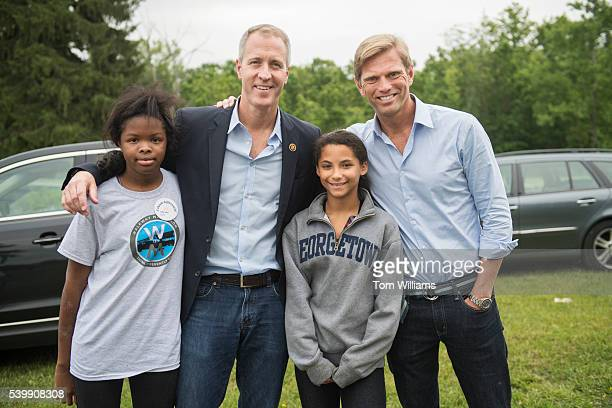 Rep Sean Patrick Maloney DNY and his husband Randy Florke right pose with their daughters Daley left and Essie in the Newburgh NY near the Water...