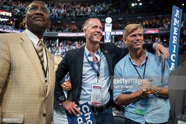 Rep Sean Patrick Maloney DNY center and his husband Randy Florke talk with Rep Gregory Meeks DNY left on the floor of the Wells Fargo Center in...