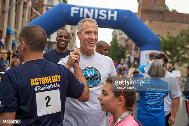 Rep Sean Patrick Maloney DNY finishes the 'Think Differently Dash' that benefits people with disabilities in Poughkeepsie NY June 11 2016