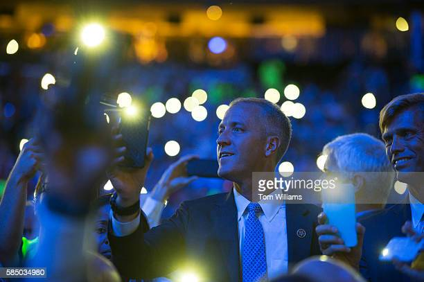 Rep Sean Patrick Maloney DNY left and his husband Randy Florke listen to Katy Perry perform at the Wells Fargo Center in Philadelphia Pa on the final...