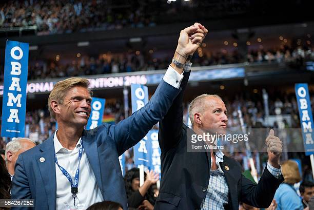 Rep Sean Patrick Maloney DNY right and his husband Randy Florke are seen on the floor of the Wells Fargo Center in Philadelphia Pa on the third day...
