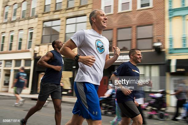 Rep Sean Patrick Maloney DNY runs during the 'Think Differently Dash' that benefits people with disabilities in Poughkeepsie NY June 11 2016