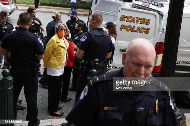 Rep. Sheila Jackson Lee and President and Chair of the Board of National Council of Negro Women Johnnetta Cole are arrested by members of U.S....