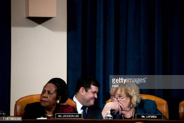 Rep Sheila Jackson Lee and Rep Zoe Lofgren look at visuals during a hearing before the House Judiciary Committee in the Longworth House Office...