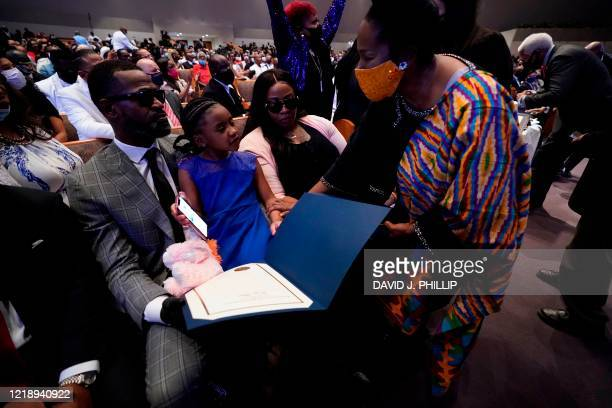 US Rep Sheila Jackson Lee DTexas speaks with Roxie Washington and Gianna Floyd the daughter of George Floyd during the funeral service for George...