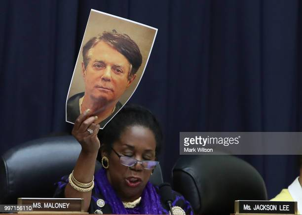 Rep Sheila Jackson Lee holds up a picture of Paul Manafort while questioning Deputy Assistant FBI Director Peter Strzok during a joint committee...