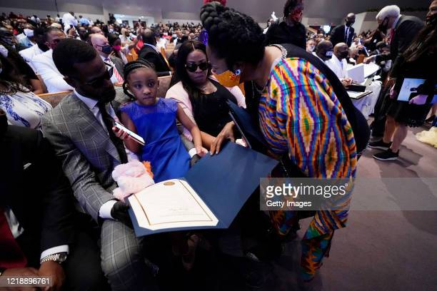 S Rep Sheila Jackson Lee speaks with Roxie Washington and Gianna Floyd the daughter of George Floyd at Floyd's funeral service in the chapel at the...