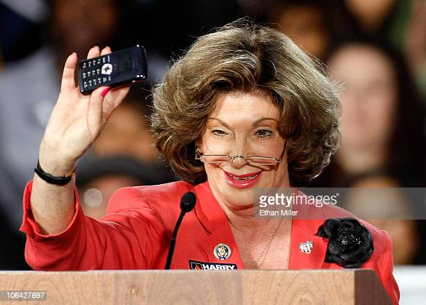 S Rep Shelley Berkley makes a campaign call on a cell phone as she speaks at a getoutthevote rally for US Senate Majority Leader Harry Reid featuring...