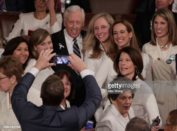 S Rep Steny Hoyer and Abigail Spanberger takes a group photo with fellow lawmakers ahead of the State of the Union address in the chamber of the US...
