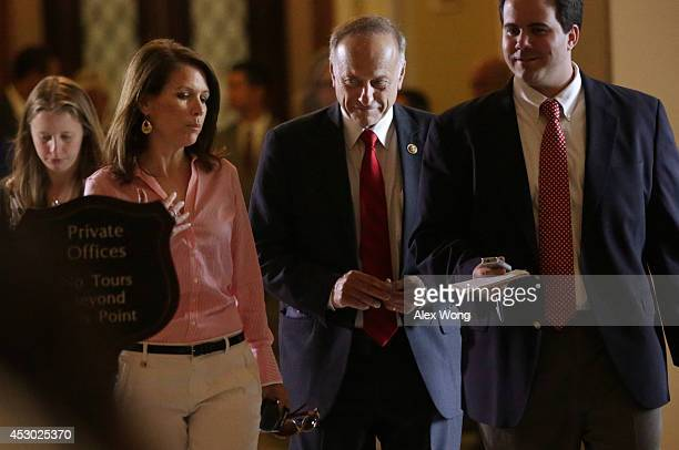 Rep. Steve King and Rep. Michele Bachmann pass through the Statuary Hall after a vote on the floor August 1, 2014 on Capitol Hill in Washington, DC....