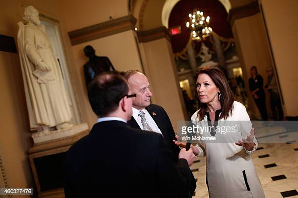 Rep. Steve King and Rep. Michele Bachmann talk with a reporter at the U.S Capitol as the House of Representatives continues a temporary recess on...