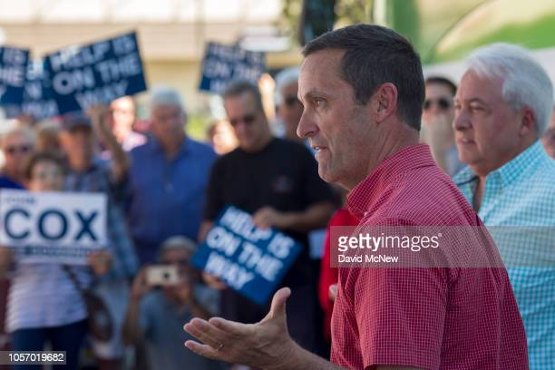 Rep. Steve Knight speaks as Republican gubernatorial candidate John Cox looks on during a get-out-the-vote rally on November 3, 2018 in Santa...