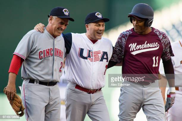 Rep Steve Scalise is helped off the field by Rep Cedric Richmond and Rep Bran Wenstroup after playing second base during the Congressional Baseball...