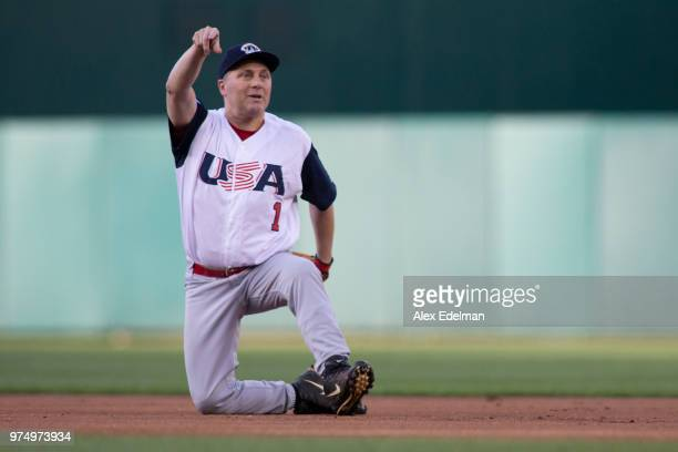 Rep Steve Scalise makes a play to first base resulting in an out after fielding a ground ball on the first pitch of the Congressional Baseball Game...