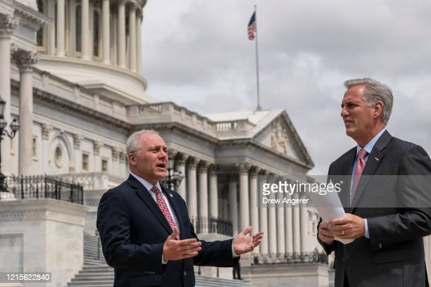 Rep. Steve Scalise talks with House Minority Leader Rep. Kevin McCarthy as they arrive for a news conference outside the U.S. Capitol, May 27, 2020...