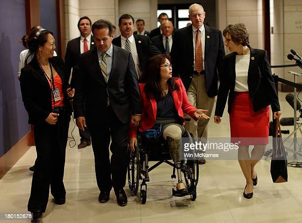 Rep Tammy Duckworth a veteran of the war in Iraq arrives for a closed intelligence briefing for members of Congress on Syria at the US Capitol...