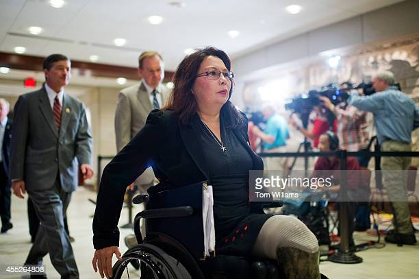 Rep Tammy Duckworth DIll makes her way to a closed briefing in the Capitol Visitor Center for House members on the administration's strategy for...