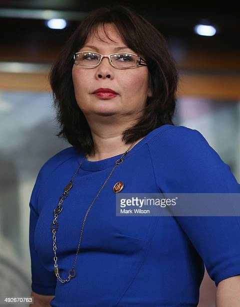 Rep Tammy Duckworth participates in a news conference on Capitol Hill May 21 2014 in Washington DC House Minority Leader Pelosi named Duckworth and...