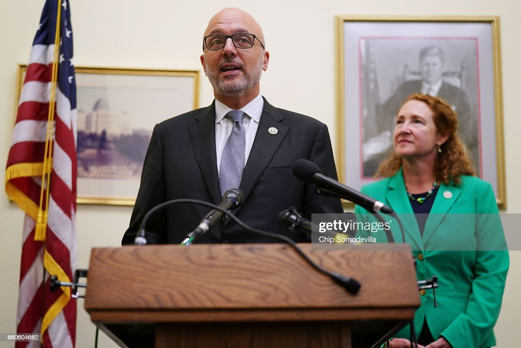 Rep. Ted Deutch (D-FL) (L) and Rep. Elizabeth Esty (D-CT) hold a news conference to introduce the 'Keeping Americans Safe Act' in the Cannon House Office Building on Capitol Hill October 12, 2017 in Washington, DC. Joined by representatives from gun safety groups, the Democrats said their proposed legislation would prohibit the 'transfer, importation, or possession of magazines able to hold more than 10 rounds of ammunition.'