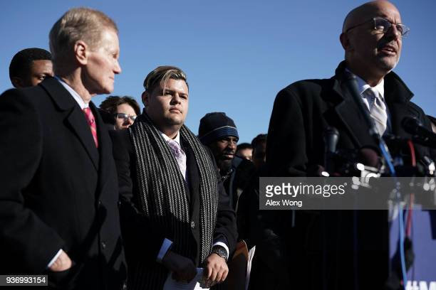 S Rep Ted Deutch speaks as Sen Bill Nelson and Marjory Stoneman Douglas High School student Demitri Hoth listen during a news conference on gun...