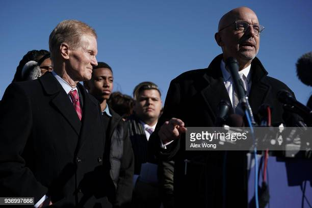 S Rep Ted Deutch speaks as Sen Bill Nelson listens during a news conference on gun control March 23 2018 on Capitol Hill in Washington DC The...