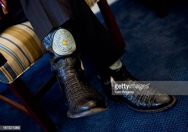 Rep Ted Poe RTexas wears Texas themed cowboy boots during a briefing with Sen Chris Coons DDel and Rep Peter Welch DVt in Coons' Russell office on...