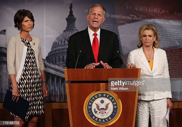 S Rep Ted Poe speaks about the sex slave industry while flanked by US Rep Carolyn Maloney and US Rep Kristi Noem during a news conference on Capitol...