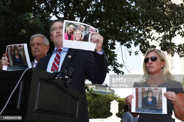 Rep. Thomas Massie speaks as Rep. Marjorie Taylor Greene and Rep. Ralph Norman listen during a news conference outside U.S. Supreme Court on July 27,...
