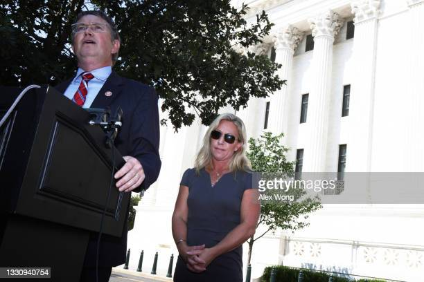 Rep. Thomas Massie speaks as Rep. Marjorie Taylor Greene listens during a news conference outside U.S. Supreme Court on July 27, 2021 in Washington,...