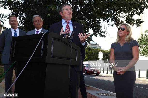 Rep. Thomas Massie speaks as Rep. Marjorie Taylor Greene listens during a news conference outside U.S. Supreme Court July 27, 2021 in Washington, DC....