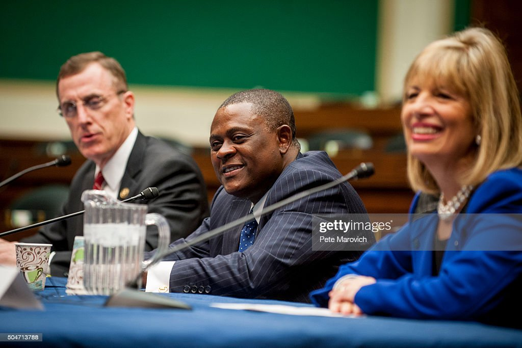 Rep. Tim Murphy (R-PA) (L) and forensic pathologist and neuropathologist Dr. Bennet Omalu participate in a briefing sponsored by Rep. Jackie Speier (D-CA), right, on Capitol Hill on January 12, 2016 in Washington, DC. Dr.Omalu is credited with discovering chronic traumatic encephalopathy, or CTE, in former NFL players.
