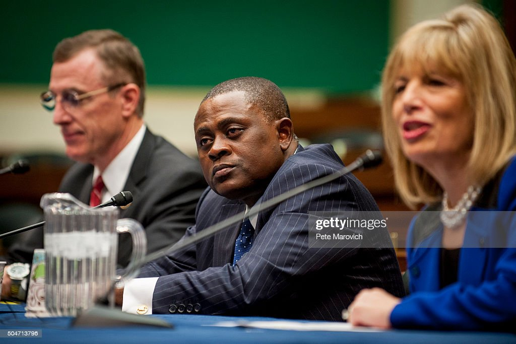 Rep. Tim Murphy (R-PA) (L), and forensic pathologist and neuropathologist Dr. Bennet Omalu (C), participate in a briefing sponsored by Rep. Jackie Speier (D-CA), right, on Capitol Hill on January 12, 2016 in Washington, DC. Dr.Omalu is credited with discovering chronic traumatic encephalopathy, or CTE, in former NFL players.