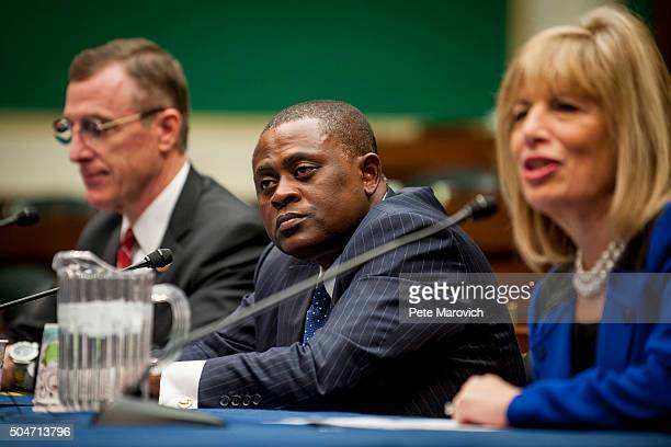 Rep Tim Murphy and forensic pathologist and neuropathologist Dr Bennet Omalu participate in a briefing sponsored by Rep Jackie Speier right on...