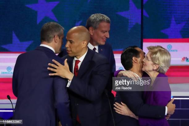 Rep Tim Ryan Sen Cory Booker New York City Mayor Bill De Blasio former housing secretary Julian Castro and Sen Elizabeth Warren embrace after the...