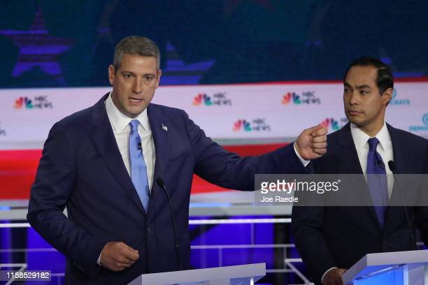 Rep. Tim Ryan speaks as former housing secretary Julian Castro looks on during the first night of the Democratic presidential debate on June 26, 2019...